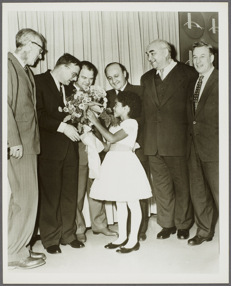 7-year-old Virginia Kay greets Shostakovich, Kabalevsky, and other Soviet composers as they arrive in the US, 1959